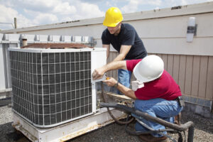 Photo of Suntide property managers performing a 5-point inspection as part of an energy efficiency audit.